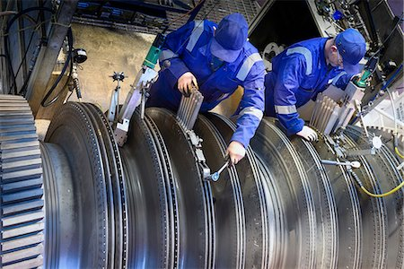 equipment - Engineers fitting blades to steam turbine in turbine repair bay Stock Photo - Premium Royalty-Free, Code: 649-07596736
