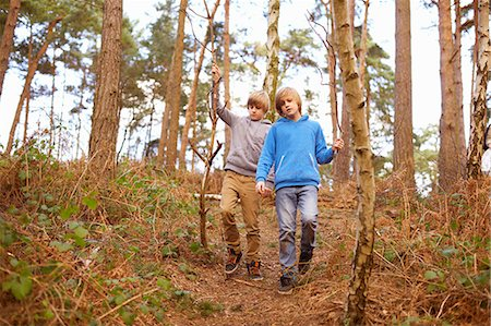 Twin brothers strolling in woods Stock Photo - Premium Royalty-Free, Code: 649-07596730