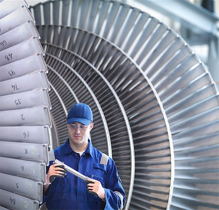 people working in factory - Engineer inspecting steam turbine blade in workshop Stock Photo - Premium Royalty-Free, Code: 649-07596745