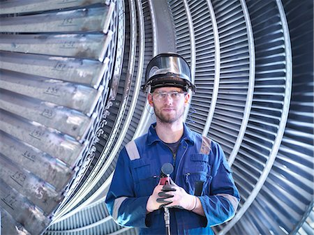 power - Portrait of apprentice engineer in steam turbine repair workshop Stock Photo - Premium Royalty-Free, Code: 649-07596748