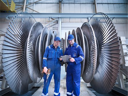power - Engineers discussing notes in front of steam turbine in workshop Stock Photo - Premium Royalty-Free, Code: 649-07596743