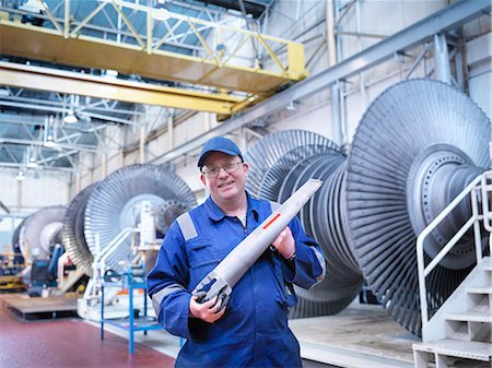 power - Portrait of engineer holding rotor blade in turbine repair workshop Stock Photo - Premium Royalty-Free, Code: 649-07596754