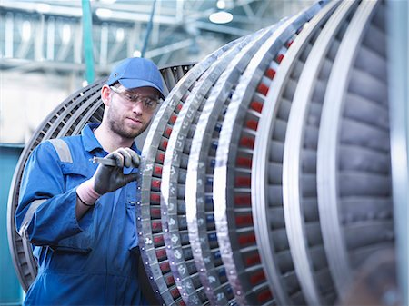 Engineer measuring high pressure steam turbine blade in workshop Stock Photo - Premium Royalty-Free, Code: 649-07596750