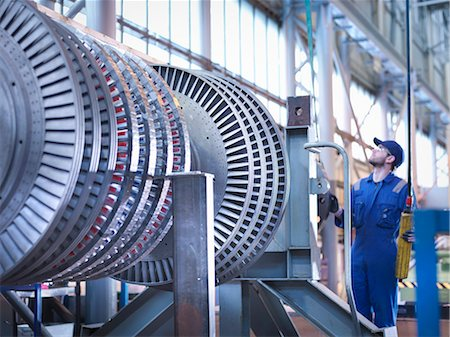 equipment - Engineer lifting high pressure steam turbine with crane in workshop Stock Photo - Premium Royalty-Free, Code: 649-07596751