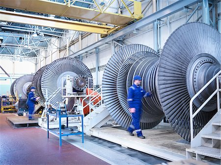 equipment - Engineers with low pressure steam turbines in repair bays in workshop Stock Photo - Premium Royalty-Free, Code: 649-07596752