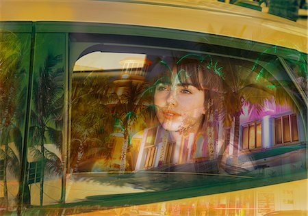 Young woman in back of taxi Stock Photo - Premium Royalty-Free, Code: 649-07596782