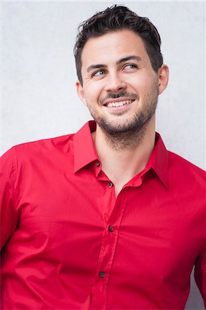 red - Portrait of smiling young man in red shirt Stock Photo - Premium Royalty-Free, Code: 649-07647763