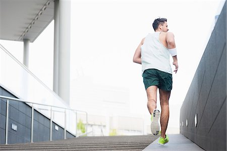 runner (male) - Jogger ascending ramp Stock Photo - Premium Royalty-Free, Code: 649-07647809