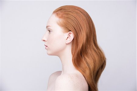 Portrait of young woman, side view, bare shoulders Stock Photo - Premium Royalty-Free, Code: 649-07647856