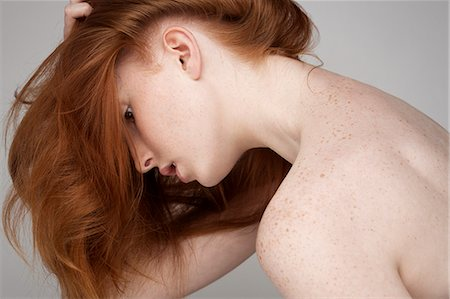 Portrait of young woman, leaning forwards with hair forwards Stock Photo - Premium Royalty-Free, Code: 649-07647870