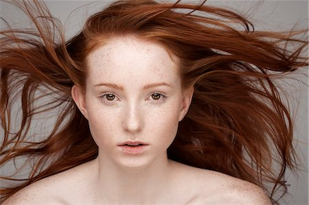 Portrait of young woman, windswept hair Stock Photo - Premium Royalty-Free, Code: 649-07647873