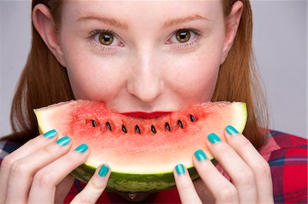 Young woman with slice of watermelon Stock Photo - Premium Royalty-Free, Code: 649-07647899