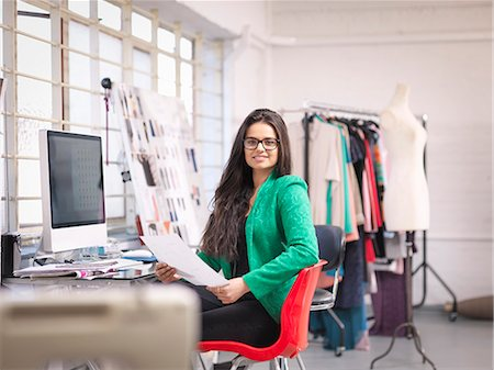 Fashion designer working at computer in fashion design studio, portrait Stock Photo - Premium Royalty-Free, Code: 649-07647995