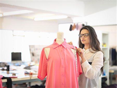 Fashion designer measuring garment in fashion design studio Stock Photo - Premium Royalty-Free, Code: 649-07648005
