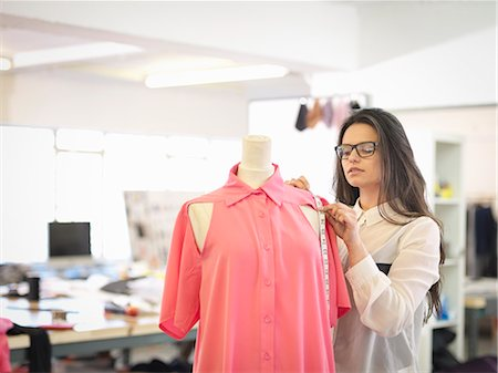 designer (female) - Fashion designer measuring garment in fashion design studio Stock Photo - Premium Royalty-Free, Code: 649-07648005