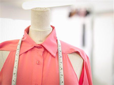 Measuring tape on garment in fashion design studio, close up Stock Photo - Premium Royalty-Free, Code: 649-07648008