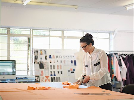 designer (female) - Fashion designer cutting cloth in fashion design studio Stock Photo - Premium Royalty-Free, Code: 649-07648002