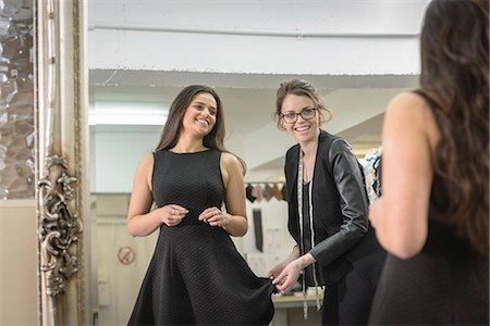 Fashion designers working together in front of mirror in fashion studio Stock Photo - Premium Royalty-Free, Code: 649-07648029