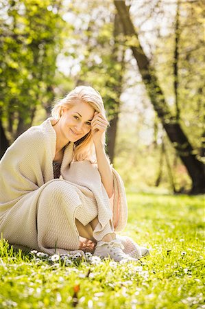 spring - Portrait of young woman wrapped in blanket in forest Stock Photo - Premium Royalty-Free, Code: 649-07648055