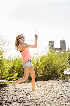 dancing - Young woman in park dancing whilst listening to headphones Stock Photo - Premium Royalty-Free, Code: 649-07648063