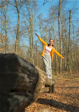 Young woman balancing on log on forest assault course Stock Photo - Premium Royalty-Free, Code: 649-07648078