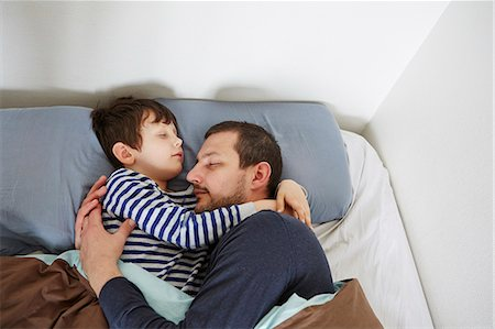 Father and son in bed Stock Photo - Premium Royalty-Free, Code: 649-07648113