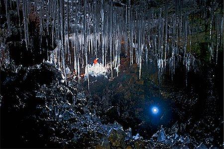Mature man and woman exploring Buri cave, Threngsli, Iceland Stock Photo - Premium Royalty-Free, Code: 649-07648206