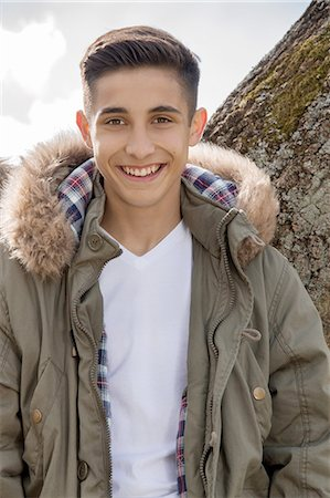 Portrait of teenage boy in parka jacket Stock Photo - Premium Royalty-Free, Code: 649-07648247