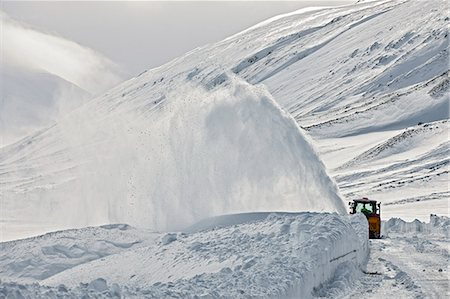 Snow blower clearing road on Oxnadalsheidi close to the town Akureyri , Iceland Stock Photo - Premium Royalty-Free, Code: 649-07648243