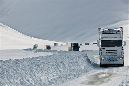 Lorries driving on snow covered highway 1, Oxnadalsheidi, North Iceland Stock Photo - Premium Royalty-Free, Code: 649-07648264