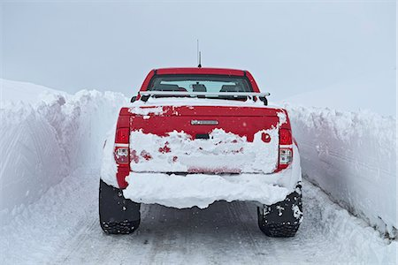 Mature woman driving red pick up truck on snow walled road, Fljotsheidi, North Iceland Stock Photo - Premium Royalty-Free, Code: 649-07648267