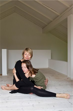 preteen touch - Mother and twelve year old daughter hugging on floor Stock Photo - Premium Royalty-Free, Code: 649-07648277