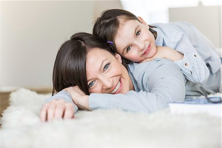 furry - Mother and daughter lying on rug Stock Photo - Premium Royalty-Free, Code: 649-07648299
