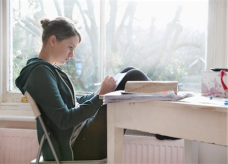 studying (all students) - Sixteen year old girl studying and writing notes next to window Stock Photo - Premium Royalty-Free, Code: 649-07648290