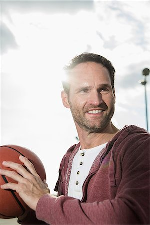 Basketball player holding basketball Stock Photo - Premium Royalty-Free, Code: 649-07648355