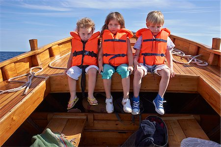 friendship - Three children sitting in boat Stock Photo - Premium Royalty-Free, Code: 649-07648399