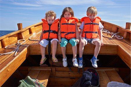 friendship - Three children sitting in boat Stock Photo - Premium Royalty-Free, Code: 649-07648399