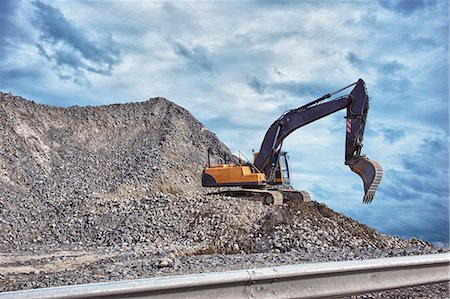 Excavator and mound of construction material Stock Photo - Premium Royalty-Free, Code: 649-07648413