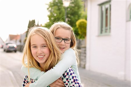 sister - Portrait of two sisters playing piggyback Stock Photo - Premium Royalty-Free, Code: 649-07648448