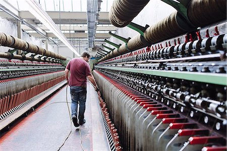 Male factory worker monitoring weaving machines in woollen mill Stock Photo - Premium Royalty-Free, Code: 649-07648499