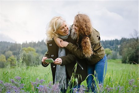 Teenage daughter and mother with smartphone Stock Photo - Premium Royalty-Free, Code: 649-07648506