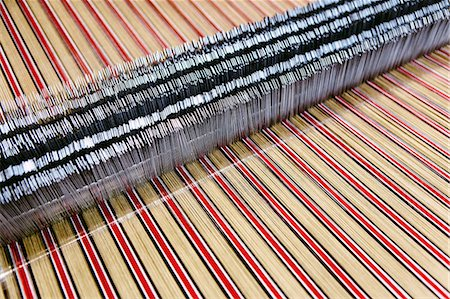 Close up of striped textile on weaving machine in woollen mill Stock Photo - Premium Royalty-Free, Code: 649-07648501