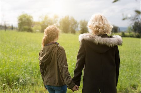 Rear view of mother and teenage daughter holding hands Stock Photo - Premium Royalty-Free, Code: 649-07648511