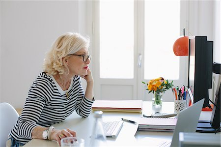 ebusiness - Mature woman at home using computer Stock Photo - Premium Royalty-Free, Code: 649-07648523