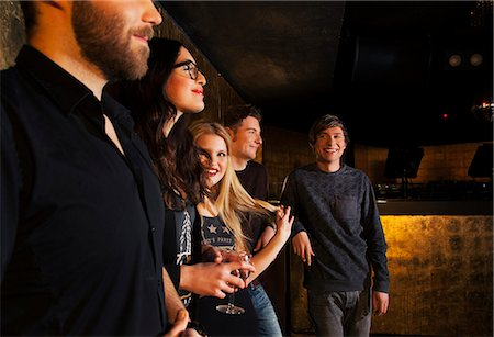 Group of male and female friends in nightclub Stock Photo - Premium Royalty-Free, Code: 649-07648576
