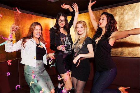 Four female friends celebrating in nightclub Stock Photo - Premium Royalty-Free, Code: 649-07648587