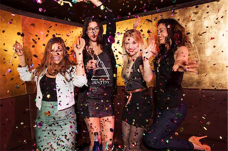 Four female friends partying in nightclub Stock Photo - Premium Royalty-Free, Code: 649-07648588