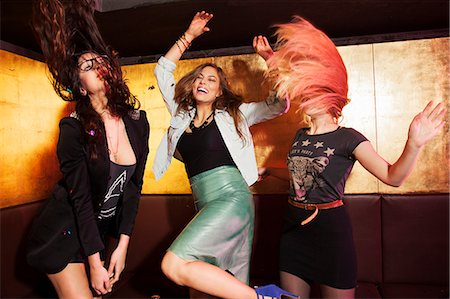 Four female friends dancing in nightclub Stock Photo - Premium Royalty-Free, Code: 649-07648589
