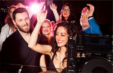 Group of young men and women dancing in nightclub Stock Photo - Premium Royalty-Free, Code: 649-07648580