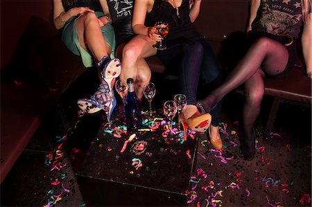Cropped shot of female mini skirted friends in nightclub Stock Photo - Premium Royalty-Free, Code: 649-07648590